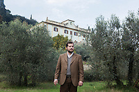 CALENZANO, ITALY - 24 NOVEMBER 2014: Olive oil producer Federico Dufour poses for a portrait in front of his farmhoue and by his olive trees in Calenzano, 20 kilometers north of Florence, Italy, on November 24th 2014.<br /> <br /> The olive harvest was practically non-existent this fall in Calenzano because of the Bactrocera oleae, an olive fruit fly that this year ravaged entire olive crops. Italy's Institute of Services for Agriculture and Food Market, or ISMEA, calculated that olive oil production fell on average by 35 percent from 302,000 tons from 463,000 the previous year.