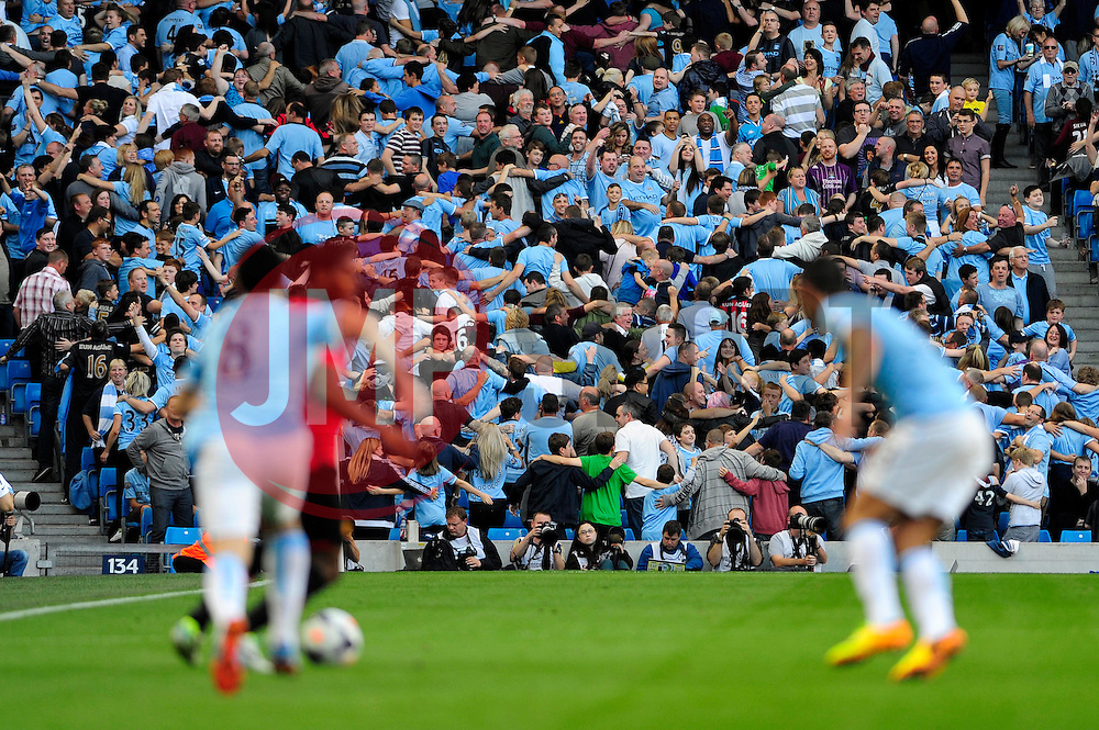 Manchester City fans celebrate by facing away from the action during the game  - Photo mandatory by-line: Dougie Allward/JMP - Tel: Mobile: 07966 386802 22/09/2013 - SPORT - FOOTBALL - City of Manchester Stadium - Manchester - Manchester City V Manchester United - Barclays Premier League