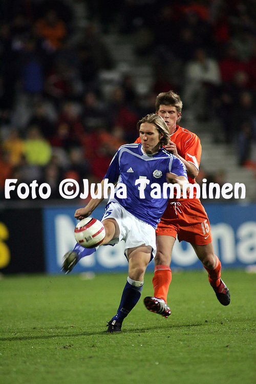 12.10.2004, Stadion De Vijverberg, Doetinchem, Holland..UEFA Under-21 European Championship qualifying match, Holland v Finland..Ari Nyman (Finland) v Klaas-Jan Huntelaar (Holland).©Juha Tamminen.....ARK:k