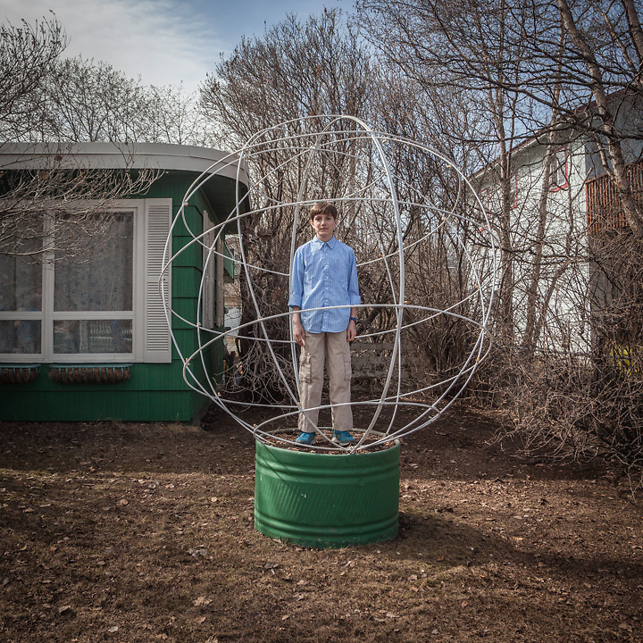 """Fin Carnahan in his grandfather's front yard, Anchorage.  """"This is the perfect photograph of Fin.  He has just turned 13 and he thinks he is the center of the universe.""""  -Fin's mother, Mara"""