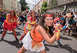 © Licensed to London News Pictures. 06/07/2019; Bristol, UK. Bristol's St Pauls Carnival with a procession through the streets of St Pauls with many Bristol schools taking part. This year's event is  designed to honour the Windrush generation and the theme of this year's event is 'Our Journey'. St Pauls has long been a multi-cultural inner city area of Bristol with a a strong Afro-Caribbean community since the Windrush generation who came to the UK from the Caribbean on the ship Empire Windrush in 1948 at the invitation of the British Government to work in the post war economy. Photo credit: Simon Chapman/LNP.