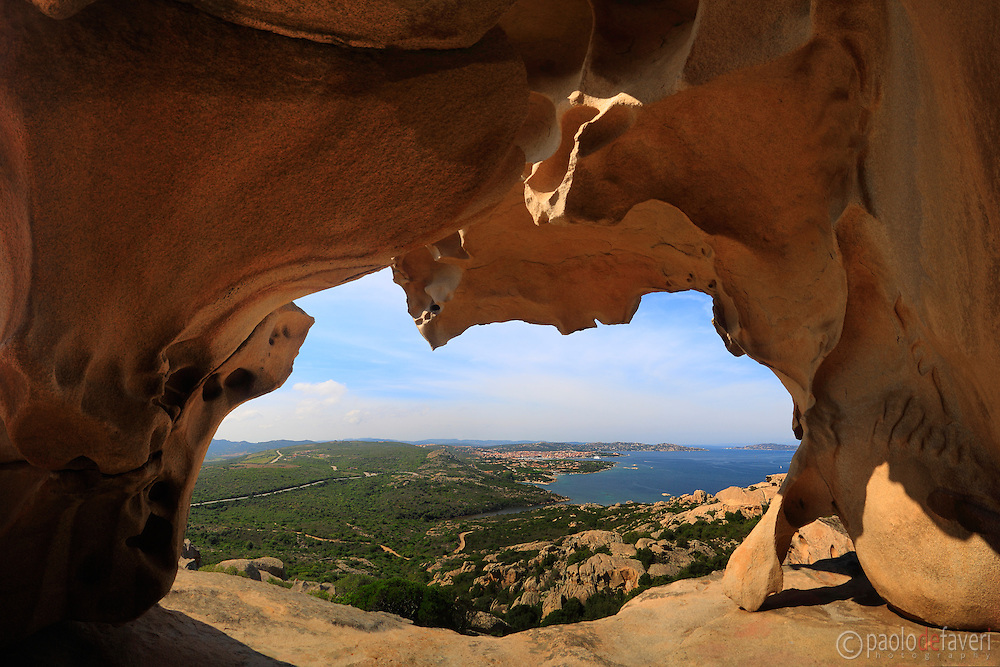 The town of Palau as seen from amazing rock formations at Capo Orso (Bear Cape) along the eastern stretch of coast known as Costa Smeranda in Sardinia, Italy
