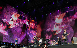 © Licensed to London News Pictures. 12/07/2014. London, UK.   The National performing live at Hyde Park as part of the British Summer Time series of outdoor concerts.   The National is an American indie rock band consisting of members Matt Berninger (lead vocals), Aaron Dessner (guitar, bass, piano, keyboards), Bryce Dessner (guitar, keyboards), Bryan Devendorf (drums), Scott Devendorf (bass, guitar, backing vocals).  Photo credit : Richard Isaac/LNP