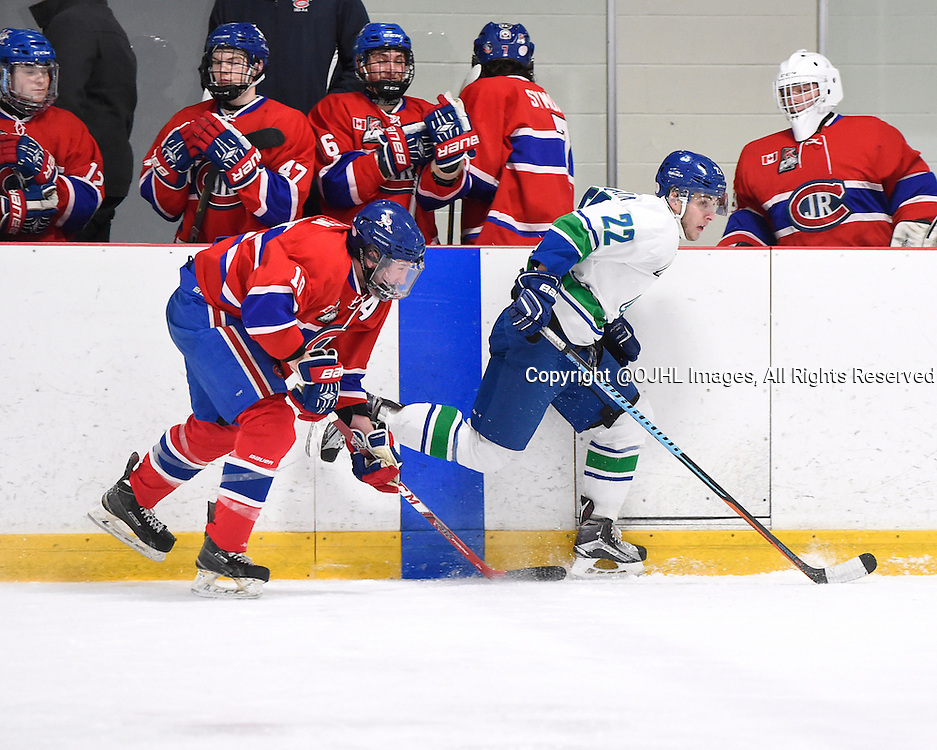 BURLINGTON, - Mar 2, 2016 -  Ontario Junior Hockey League game action between Burlington Cougars and the Toronto Junior Canadians. Game 1 of the first round playoff series at the Appleby Ice Centre, ON. Andrew Mullen #10 of the Toronto Jr Canadiens battles for control with James Mclaughlin #22 of the Burlington Cougars during the third period.<br /> (Photo by Andy Corneau / OJHL Images)