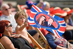 LOCATION, UK  29/04/2011. The Royal Wedding of HRH Prince William to Kate Middleton. A young boy waves a flag in the sunshine at  castle square in Swansea where crowds have gathered to watch the wedding on a giant screen. Photo credit should read Aled Llywelyn/LNP.