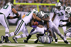 Sept 13, 2011; East Rutherford, NJ, USA; New York Jets defensive end Vernon Gholston (50)and New York Jets linebacker David Harris (52) force Baltimore Ravens running back Willis McGahee (23) to fumble during the first half at the New Meadowlands Stadium.