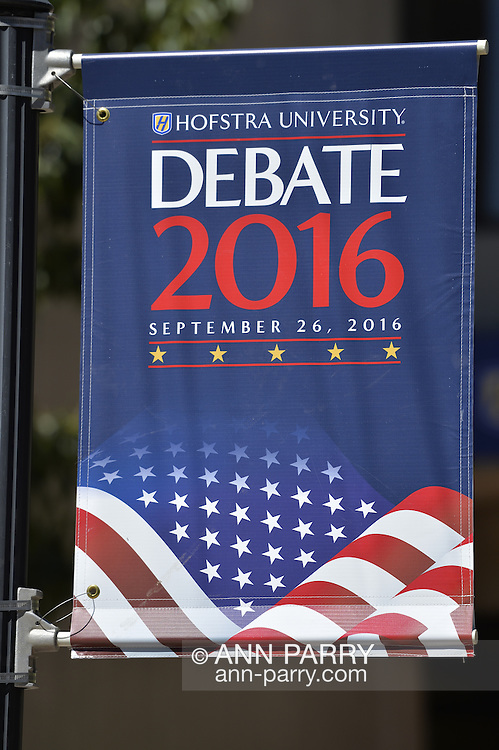 Hofstra University Debate 2016 banner, with American flag in patriotic red white and blue, is one of many displayed on the campus of Hofstra University, which will host the first Presidential Debate, between H.R. Clinton and D. J. Trump, scheduled for later that month on September 26. Hofstra is first university ever selected for 3 consecutive U.S. presidential debates.
