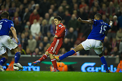 LIVERPOOL, ENGLAND - Tuesday, March 13, 2012: Liverpool's Luis Alberto Suarez Diaz sets up team-mate captain Steven Gerrard for his hat-trick goal against Everton during the Premiership match at Anfield. (Pic by David Rawcliffe/Propaganda)
