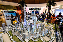 Large model of current and propsed property development with many apartment towers in Downtown Dubai by developer Emaar at Dubai Mall in United Arab Emirates