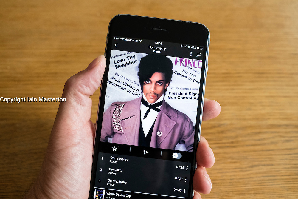 Detail of Tidal music streaming app screen showing Prince on iPhone 6 smart phone