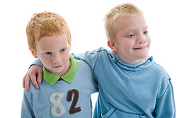 Portrait of two little brothers in the studio,