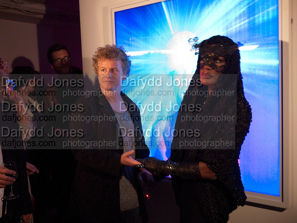 GRACE JONES; CHRIS LEVINE, Stillness at the Speed of Light exhibition. Chris Levine series of  portraits of  Grace Jones.  VINYL FACTORY. POLAND ST. LONDON. 29 APRIL 2010 *** Local Caption *** -DO NOT ARCHIVE-© Copyright Photograph by Dafydd Jones. 248 Clapham Rd. London SW9 0PZ. Tel 0207 820 0771. www.dafjones.com.<br /> GRACE JONES; CHRIS LEVINE, Stillness at the Speed of Light exhibition. Chris Levine series of  portraits of  Grace Jones.  VINYL FACTORY. POLAND ST. LONDON. 29 APRIL 2010