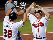 ATLANTA - AUGUST 13:  Outfielder Rick Ankiel #28 of the Atlanta Braves congratulates teammate and third baseman Brooks Conrad #26 after Conrad's seventh inning home run during the game against the Los Angeles Dodgers at Turner Field on August 13, 2010 in Atlanta, Georgia.  The Braves beat the Dodgers 1-0. (Photo by Mike Zarrilli/Getty Images)