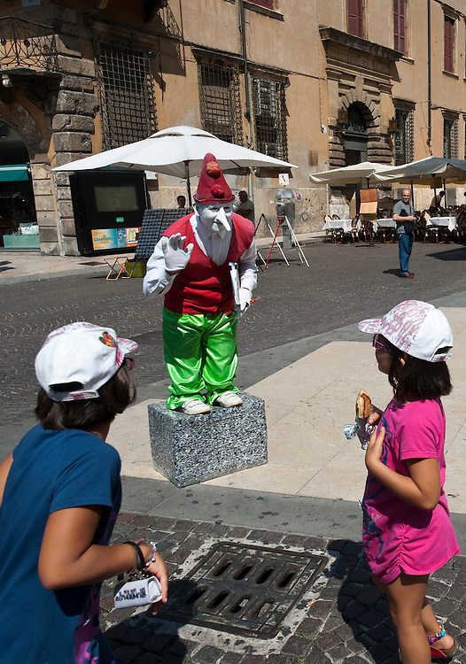 A Pinocchio plays with children in Verona.Verona is a city in Veneton, Northern Italy home to approx. 265,000 inhabitants and one of the seven provincial capitals of the region. Verona has Roman origins and  derived importance from being at the intersection of many roads. It is world famous for the Arena and its Opera....***Agreed Fee's Apply To All Image Use***.Marco Secchi /Xianpix. tel +44 (0) 207 1939846. e-mail ms@msecchi.com .www.marcosecchi.com