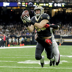 Nov 22, 2018; New Orleans, LA, USA; New Orleans Saints tight end Dan Arnold (85) catches a touchdown over Atlanta Falcons safety Sharrod Neasman (41) during the third quarter at the Mercedes-Benz Superdome. Mandatory Credit: Derick E. Hingle-USA TODAY Sports