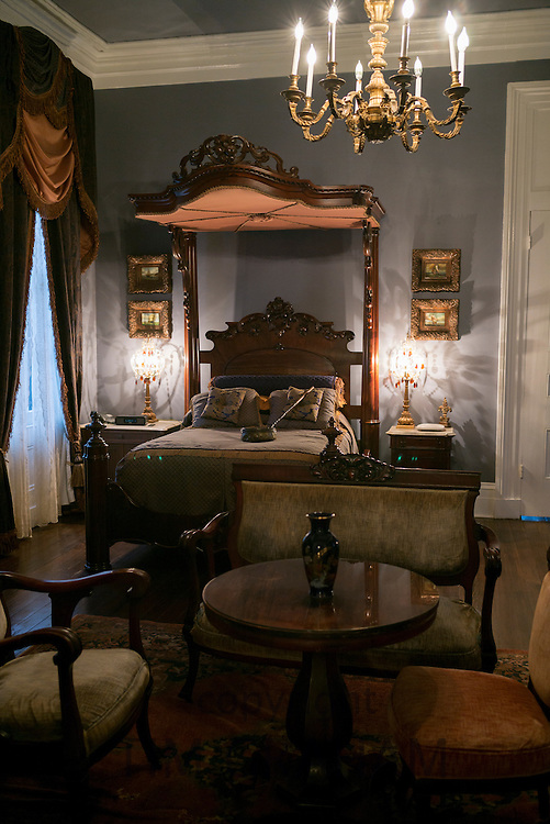 Nottoway plantation 19th Century antebellum mansion master bedroom with chandelier and half-tester bed in Louisiana, USA
