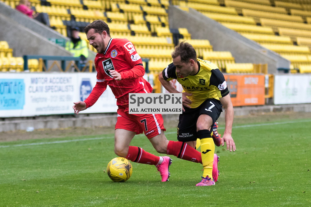 St. Mirren's Paul McMullan is sent tumbling by Livingston's Scott Pittman in the Livingston vs St. Mirren Scottish Championship 17th October 2015......(c) MARK INGRAM | SportPix.org.uk