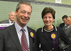 © Licensed to London News Pictures. 01/03/2013. Eastleigh, UK UKIP leader Nigel Farage and Candidate Diane James arrive at the count. Ballot boxes begin to arrive at the count centre at  Fleming Park Leisure Centre in Eastleigh this evening. The voters of Eastleigh vote to choose a new MP in a by-election prompted by the resignation of former Lib Dem cabinet minister Chris Huhne. Polling will continued 22:00 GMT 28/02/13, with votes counted overnight on Thursday. There are 14 candidates in total on the ballot papers.. Photo credit : Stephen Simpson/LNP