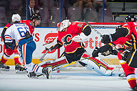 PENTICTON, CANADA - SEPTEMBER 8: Tyler Parsons #82 of Calgary Flames deflects a shot during second period against the Edmonton Oilers on September 8, 2017 at the South Okanagan Event Centre in Penticton, British Columbia, Canada.  (Photo by Marissa Baecker/Shoot the Breeze)  *** Local Caption ***