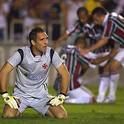 Julio Cesar (right) celebrates with team mates after scoring for Fluminense as Vasco goalkeeper Fernando Prass shows his disappointment at conceding  during the Fluminense FC V CR Vasco da Gama Futebol Brasileirao League match at the Maracana, Jornalista Mário Filho Stadium,  The match ended in a 2-2 draw. Rio de Janeiro,  Brazil. 22nd August 2010. Photo Tim Clayton