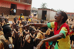 Ghana, Accra, Kokomlemle, 2007. Miss Portia leads her elementary students in a patriotic song prior to Ghana's Independence Day celebrations...