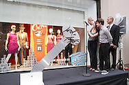 """Daniel Radcliffe, John Larroquete, Rose Hemingway and Rich Weiner, Regional Vice President of Stores for Lord & Taylor outside Lord & Taylor Fifth Ave Store as """"How to Succeed in Business Without Really Trying"""" Musical themed windows are unveiled on June 23, 2011. Photo by Lia Chang/Lord & Taylor"""