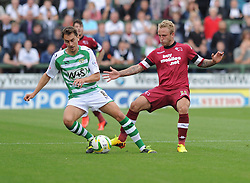 Yeovil Town's Edward Upson plays the ball past Derby County's Johnny Russell  - Photo mandatory by-line: Alex James/JMP - Tel: Mobile: 07966 386802 24/08/2013 - SPORT - FOOTBALL - Huish Park - Yeovil -  Yeovil Town V Derby County - Sky Bet Championship
