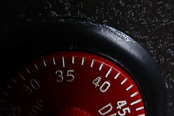 30 January 2012:   Red dial of a combination lock on a toy steel gray bank.