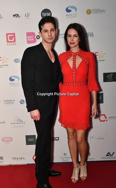 Ross William Wild and Charlotte Beckett film actress attend the BritAsiaTV Presents Kuflink Punjabi Film Awards 2019 at Grosvenor House, Park Lane, London,United Kingdom. 30 March 2019