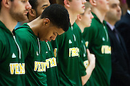 Catamounts guard Trae Bell-Haynes (2) and the rest of the team listen to the National Anthem before the start of the men's basketball game between the Binghamton Bearcats and the Vermont Catamounts at Patrick Gym on Monday night January 19, 2015 in Burlington, Vermont. (BRIAN JENKINS, for the Free Press)