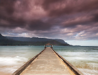 Hanalei pier and morning clouds on famous Hanalei Bay, island of Kauai, Hawaii.