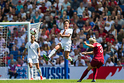 Sarah Gregorius (New Zealand) in the air attempting to intercept the ball from Alex Greenwood (England) during the FIFA Women's World Cup UEFA warm up match between England Women and New Zealand Women at the American Express Community Stadium, Brighton and Hove, England on 1 June 2019.
