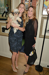 Left to right, CHARLOTTE HANSON and her bog Bella with ELAINE HANSON at A Date With Your Dog At George in aid of the Dogs Trust held at George, 87-88 Mount Street, London on 9th September 2014.