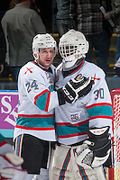 KELOWNA, CANADA - APRIL 12: Tyson Baillie #24 congratulates Michael Herringer #30 of Kelowna Rockets  on the win against the Victoria Royals on April 12, 2016 at Prospera Place in Kelowna, British Columbia, Canada.  (Photo by Marissa Baecker/Shoot the Breeze)  *** Local Caption *** Michael Herringer; Tyson Baillie;