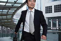 China Hong Kong business man running through footbridge