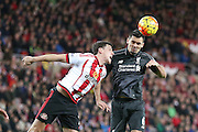 Sunderland defender Billy Jones and Liverpool defender Dejan Lovren  challenge for the ball during the Barclays Premier League match between Sunderland and Liverpool at the Stadium Of Light, Sunderland, England on 30 December 2015. Photo by Simon Davies.