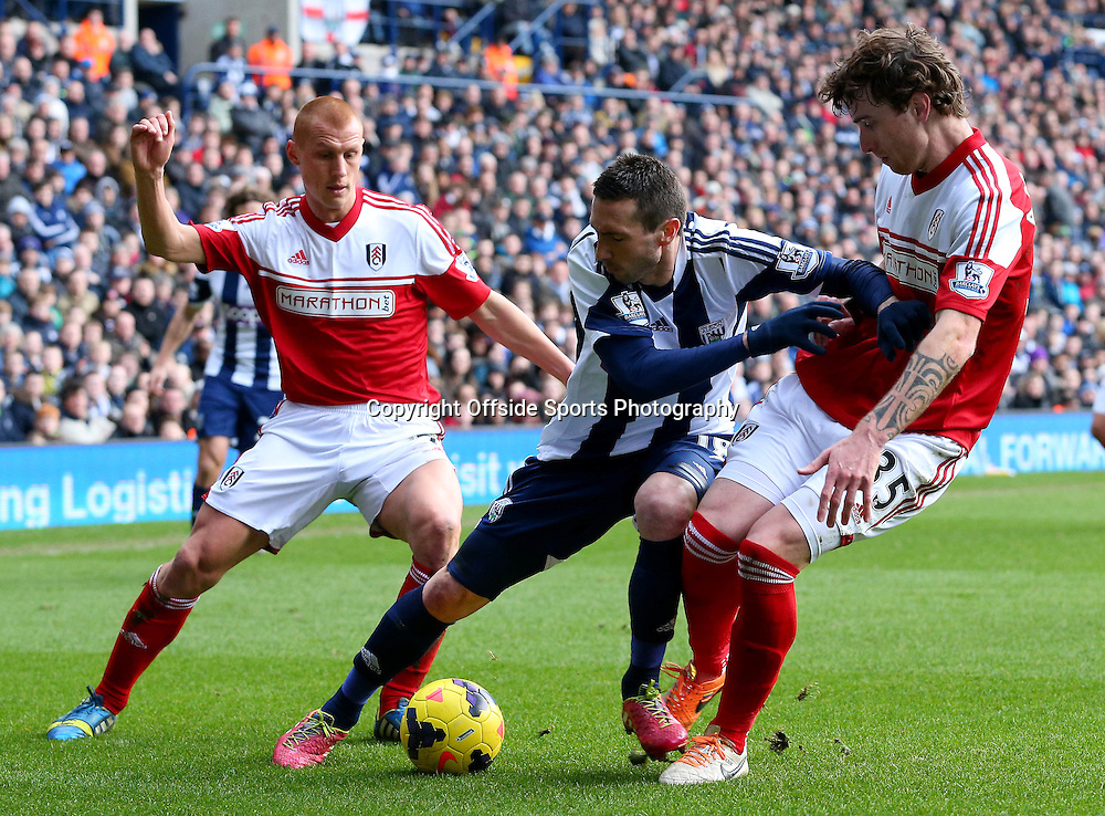 22 February 2014 - Barclays Premier League - West Bromwich Albion v Fulham - Morgan Amalfitano of West Bromwich Albion battles with Steve Sidwell (L) and Fernando Amorebieta of Fulham - Photo: Paul Roberts / Offside.