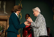 One of the Laureates, Rosi Gollman from Germany receiving the globe from H.M. Queen Silvia.<br />