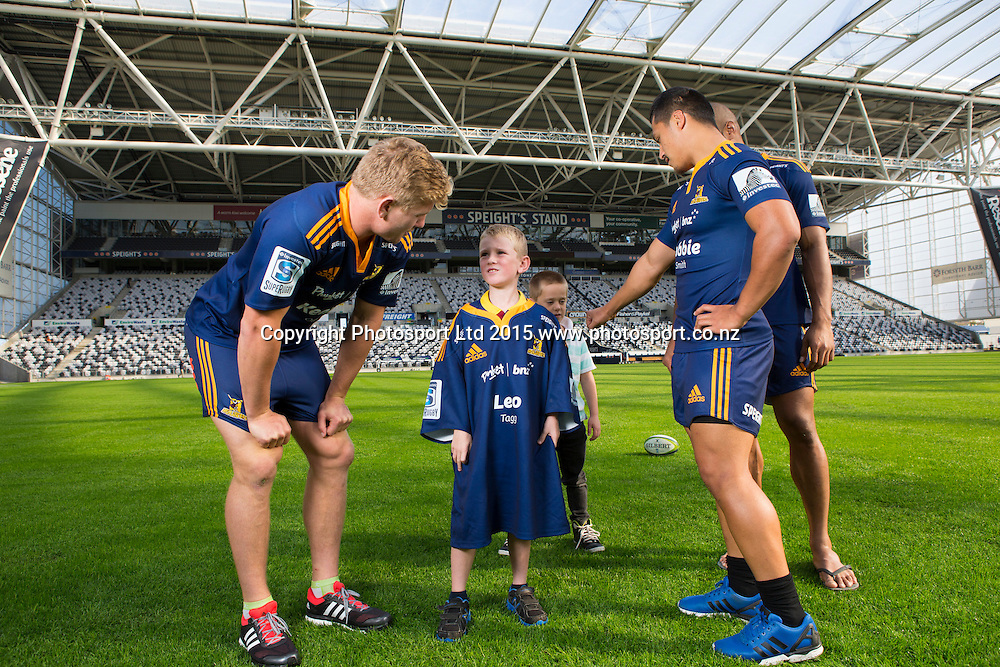 Highlander's player James Lentjes (left), chats with BNZ Future Star Leo Tagg (6) as they present the BNZ Future Stars playing shirts at Forsyth Barr Stadium, Dunedin, 16 April 2015. Photo: Derek Morrison/www.photosport.co.nz