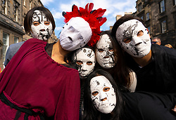 Edinburgh, Scotland, UK. 3 August 2019. On the first weekend of the Edinburgh Fringe Festival good weather brought out thousands of tourists to enjoy the many street performers  on the Royal Mile in Edinburgh Old Town. Pictured, artists from Goldsmiths CTTA Society, Goldsmiths Confucius Institute for Dance and Performance in costume for production of Chaos. Iain Masterton/Alamy Live News