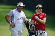 Jul 12, 2015; Lancaster, PA, USA; Charley Hull (right) and caddie Gary Wildman (left) on the second fairway during the final round of the U.S. Women's Open at Lancaster Country Club.