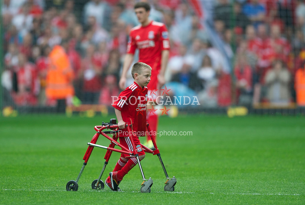 LIVERPOOL, ENGLAND - Saturday, April 23, 2011: Liverpool's mascot wheels himself off the pitch before the Premiership match against Birmingham City at Anfield. (Photo by David Rawcliffe/Propaganda)