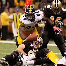 Oct 31, 2010; New Orleans, LA, USA; New Orleans Saints quarterback Drew Brees (9) is stripped of the ball by the Pittsburgh Steelers defense during the second half at the Louisiana Superdome. The Saints defeated the Steelers 20-10.  Mandatory Credit: Derick E. Hingle..