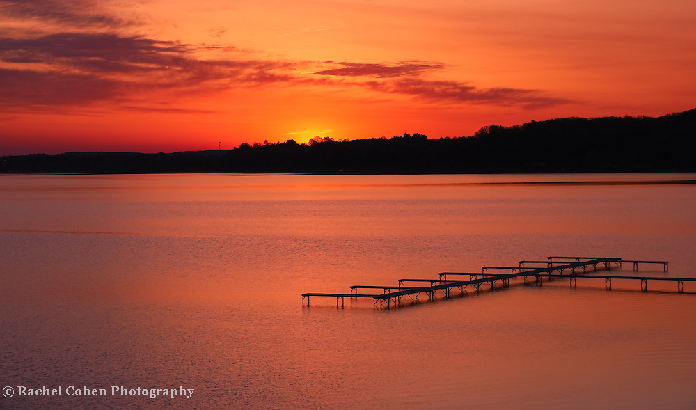 &quot;Dawn of fire&quot;<br /> <br /> A wonderful and fiery sunrise and silhouette in Traverse City Michigan on Grand Traverse Bay!