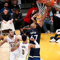 25 December 2017: Minnesota Timberwolves forward Taj Gibson (67) goes for the layup past Los Angeles Lakers forward Kyle Kuzma (0) during the Minnesota Timberwolves 121-104 victory over the LA Lakers, at the Staples Center, Los Angeles, California, USA.