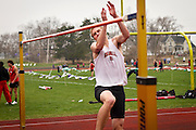 Griffin Lentsch '13 eyes the bar during his high jump attempt at the Cornell College Open track meet last saturday.