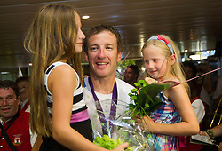 Iztok Cop with daughters Amber and Ruby during reception of Slovenian Olympic team, on August 5, 2012 in Airport Joze Pucnik, Brnik, Slovenia. (Photo by Vid Ponikvar / Sportida.com)