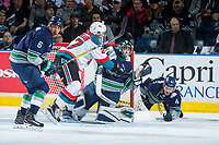 KELOWNA, CANADA - APRIL 26: Calvin Thurkauf #27 of the Kelowna Rockets is checked by Aaron Hyman #6 into Carl Stankowski #1 as Turner Ottenbreit #4 of the Seattle Thunderbirds falls behind the net on April 26, 2017 at Prospera Place in Kelowna, British Columbia, Canada.  (Photo by Marissa Baecker/Shoot the Breeze)  *** Local Caption ***