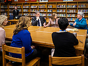"08 APRIL 2019 - DES MOINES, IOWA: Rep. TIM RYAN and his wife, ANDREA RYAN, listen to teachers in the library at Callanan Middle School. Ryan, a candidate for the Democratic ticket of the US presidency, visited Callanan Middle School in Des Moines to discuss education issues. Ryan declared his candidacy on the US television show ""The View"" on April 4. Ryan, 45 years old, represents Ohio's 13th District, which includes Lordstown, where a large General Motors plant recently closed. He is the latest Democrat to announce his candidacy to be the Democratic nominee in the 2020 election. Iowa holds its presidential caucuses on Feb. 3, 2020.       PHOTO BY JACK KURTZ"
