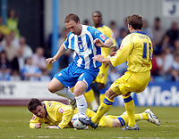 Photo: Olly Greenwood.<br />Colchester United v Leeds United. Coca Cola Championship. 09/04/2007. Colchester's Kevin Watson is surrounded by Leeds' Alan Thompson and Eddie Lewis